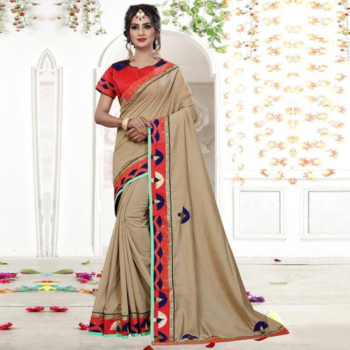 Starring Chiku Colored Party Wear Embroidered Silk Saree