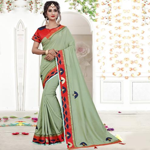 Entrancing Light Olive Green Colored Party Wear Embroidered Silk Saree