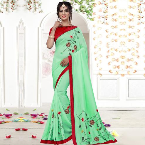 Engrossing Turquoise Colored Party Wear Embroidered Georgette Saree