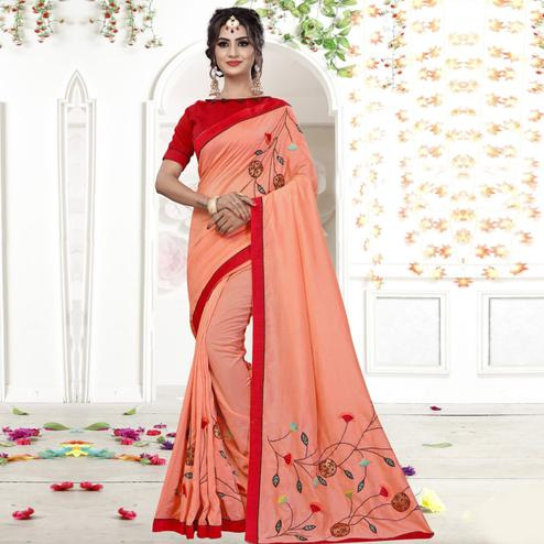 Staring Peach Colored Party Wear Embroidered Georgette Saree