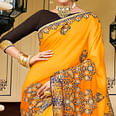Stunning Yellow Colored Partywear Embroidered Silk Georgette Saree
