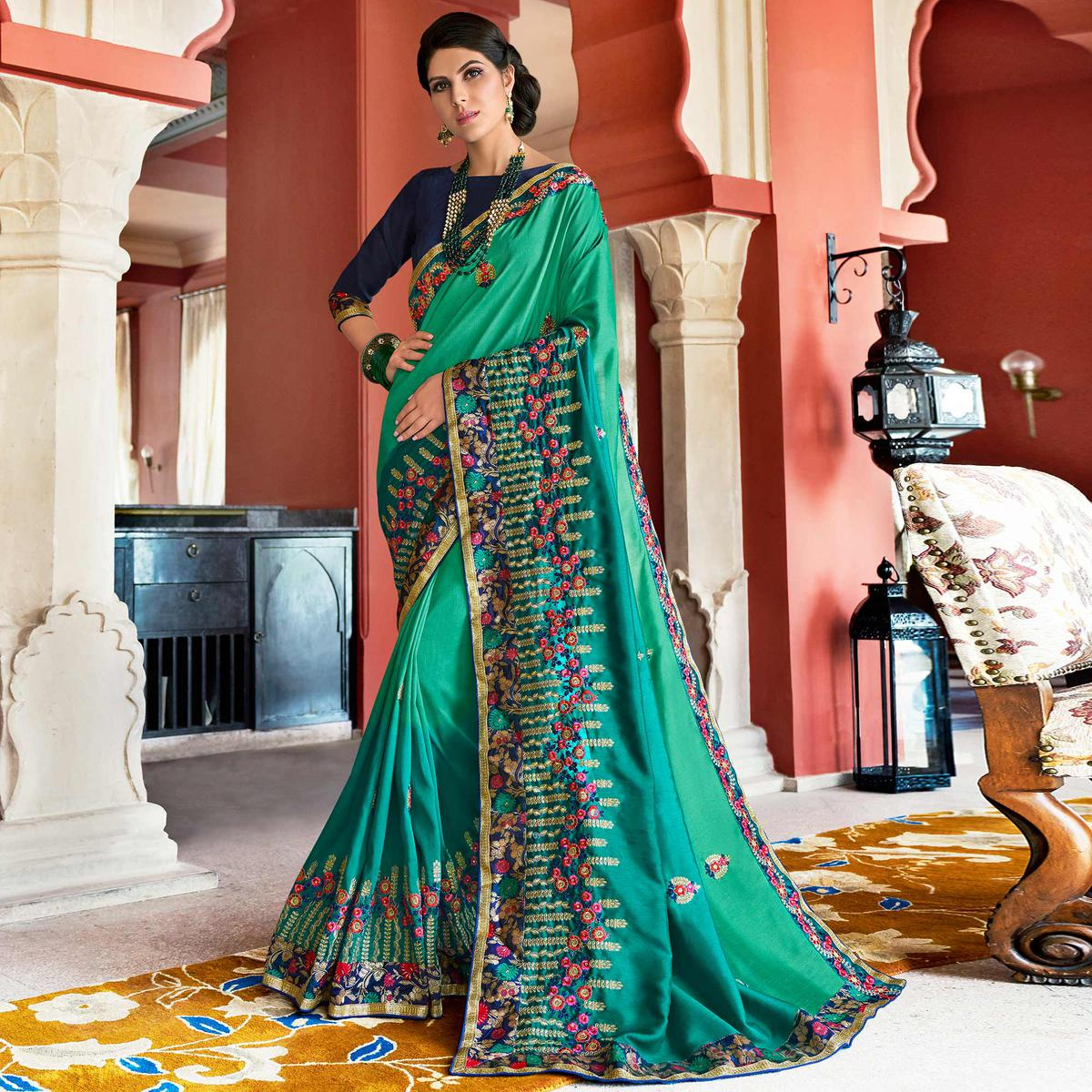 Classy Aqua Green Colored Partywear Embroidered Silk Saree