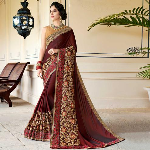 Hypnotic Maroon Colored Partywear Embroidered Art Silk Saree