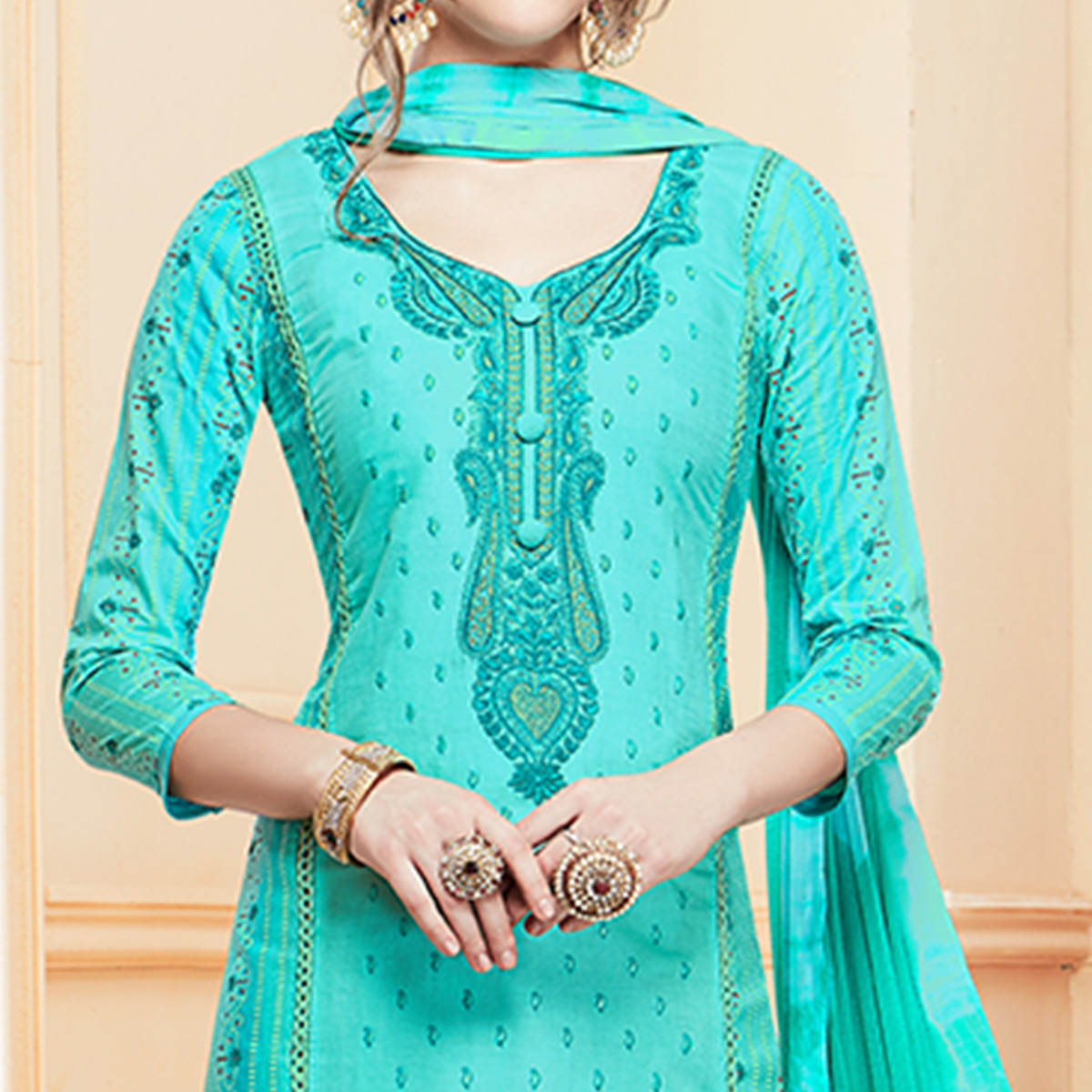 Glowing Aqua Blue Colored Partywear Embroidered Cotton Suit