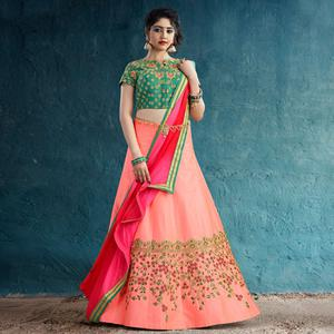Gleaming Peach Colored Party Wear Embroidered Silk Lehenga