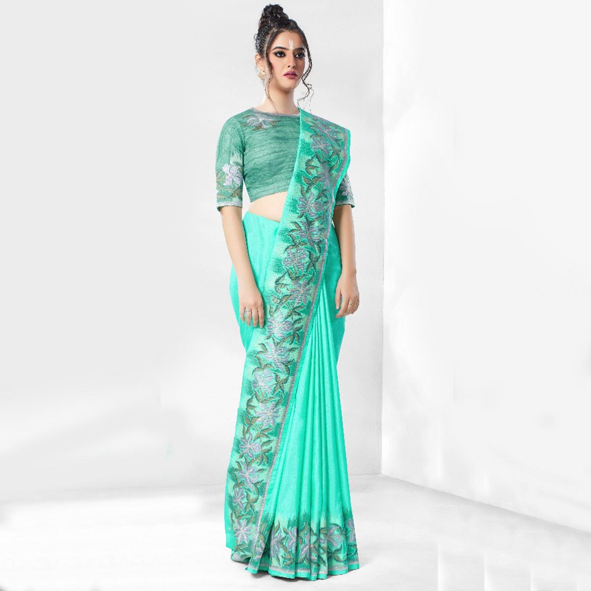 Alluring Turquoise Colored Party Wear Embroidered Art Silk Saree