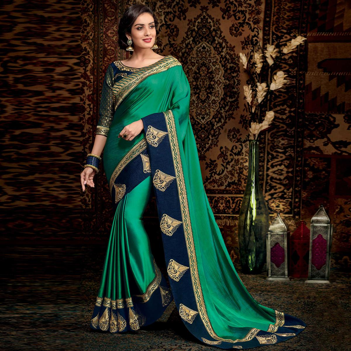 Gleaming Turquoise Green Colored Partwear Embroidered Silk Saree