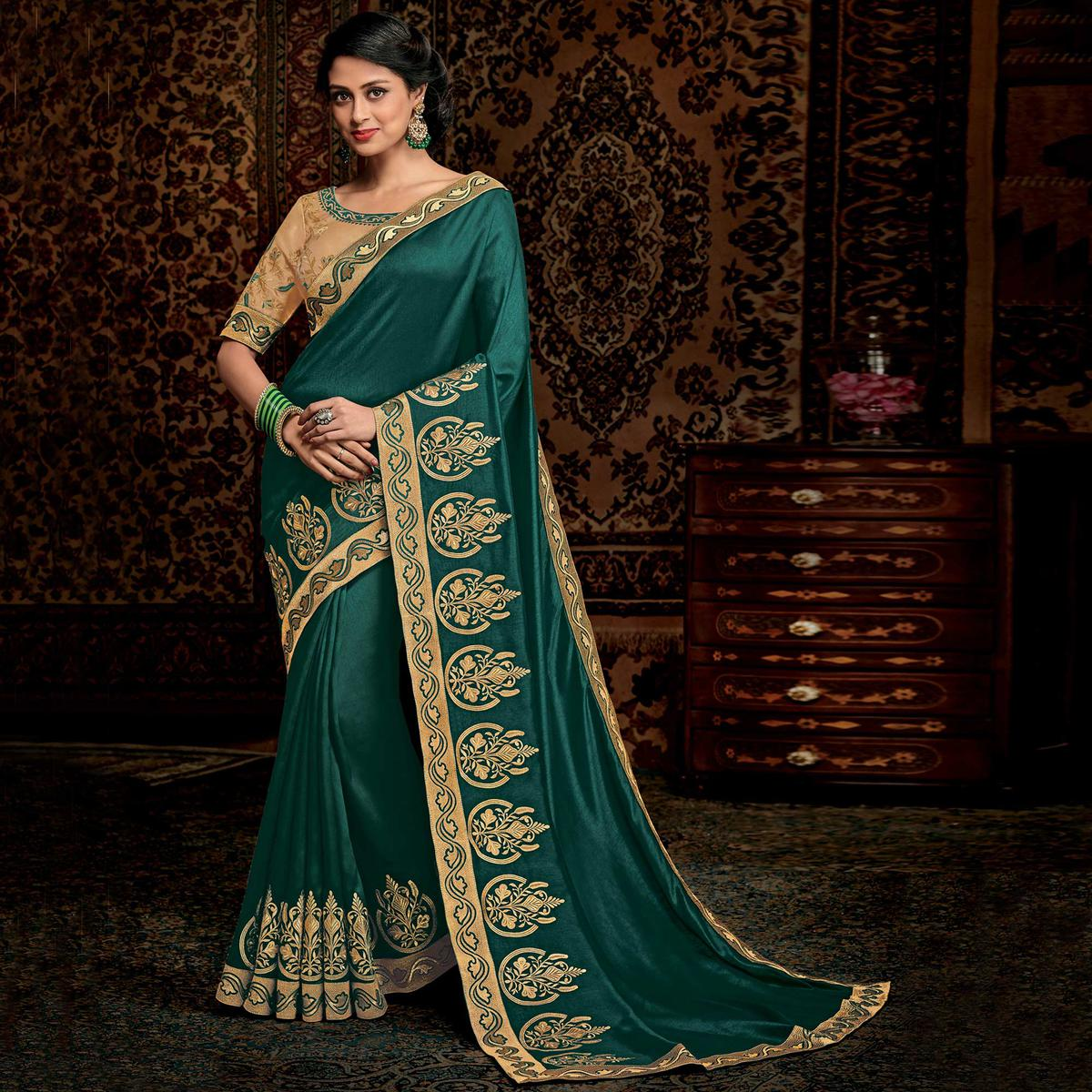 Unique Teal Green Colored Partwear Embroidered Silk Saree