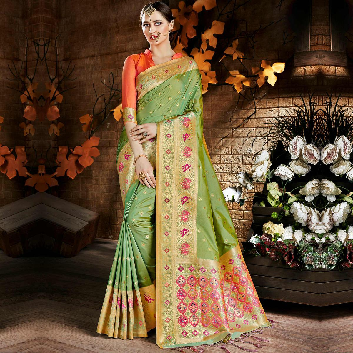Lovely Green Colored Festive Wear Woven Art Silk Saree