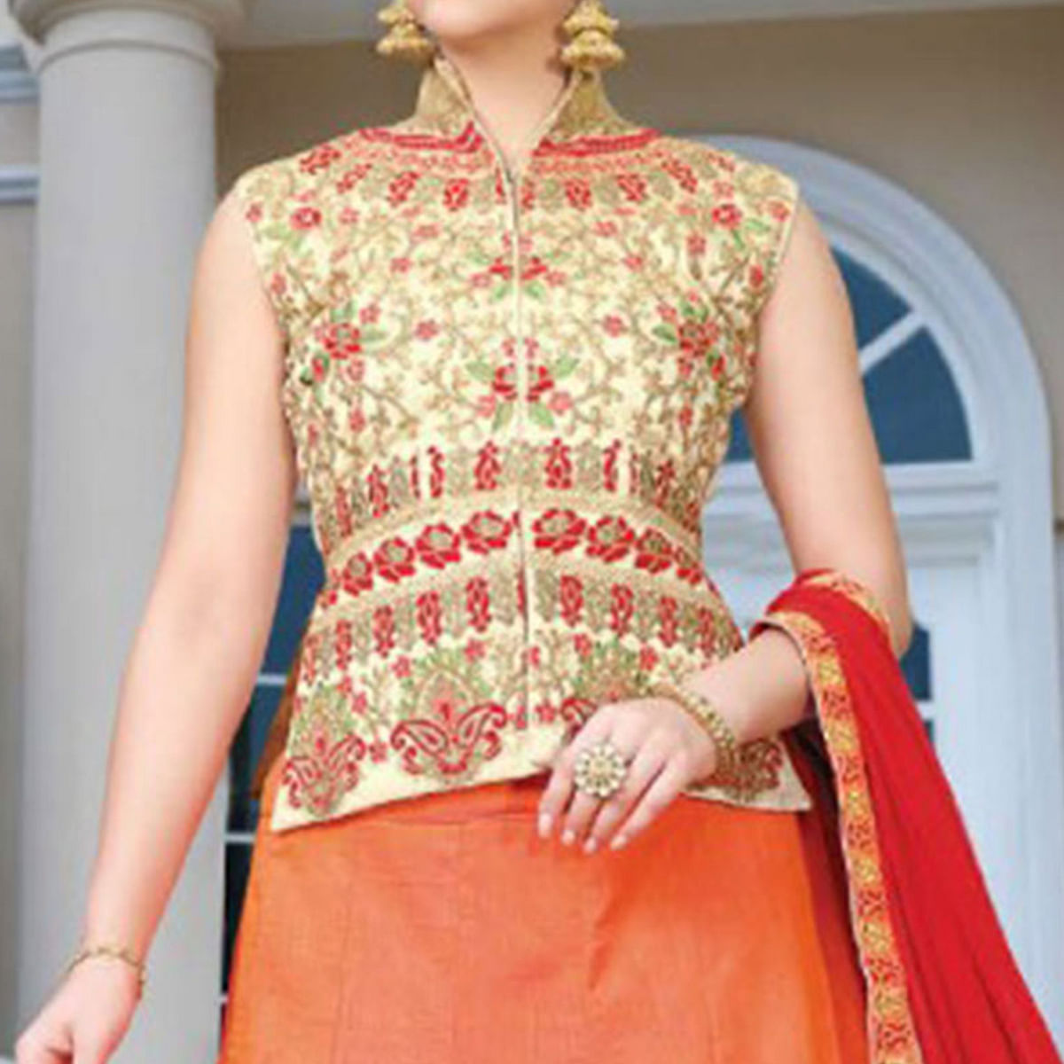 Beautiful Orange Colored Partywear Embroidered Silk Lehenga Choli