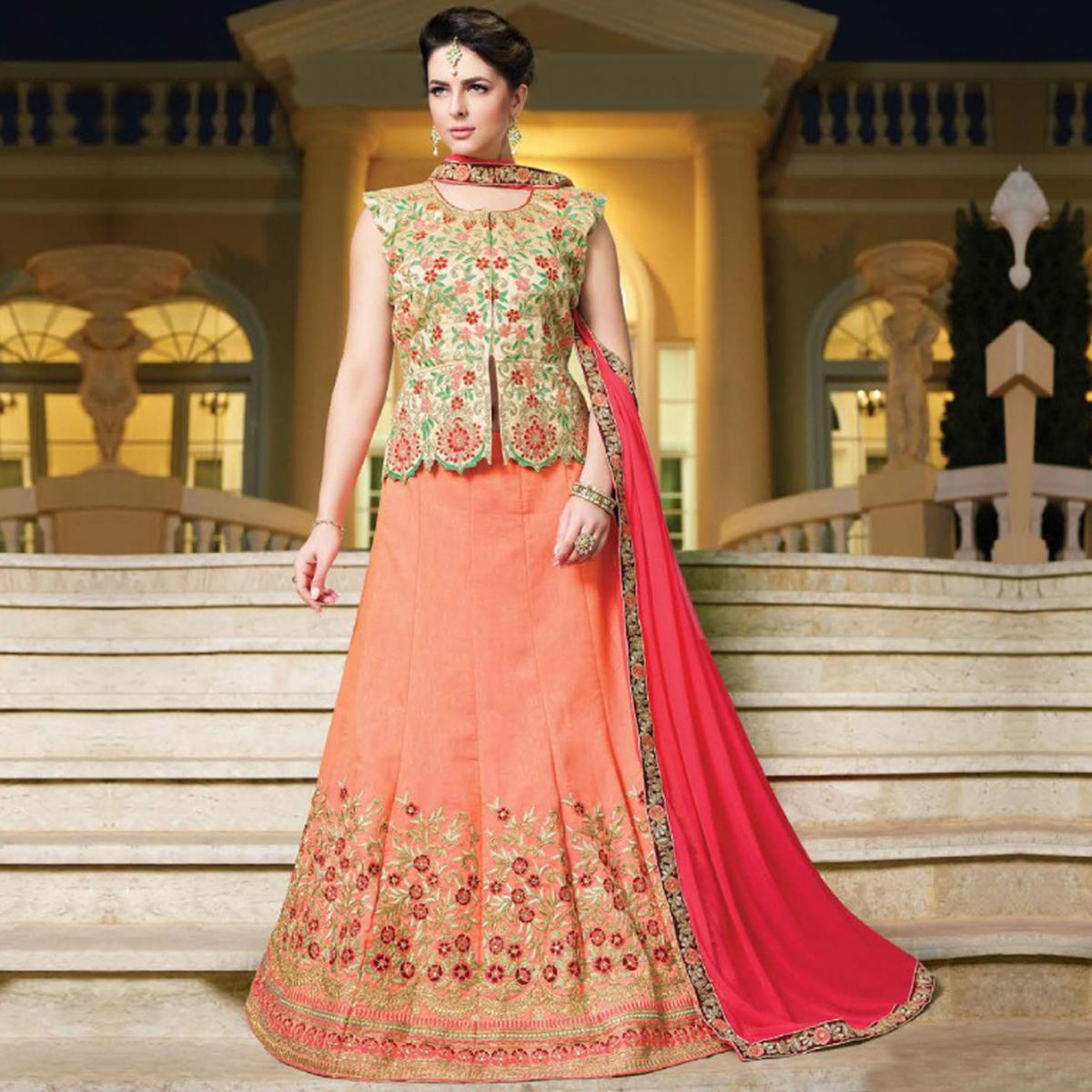 Arresting Peach Colored Partywear Embroidered Silk Lehenga Choli