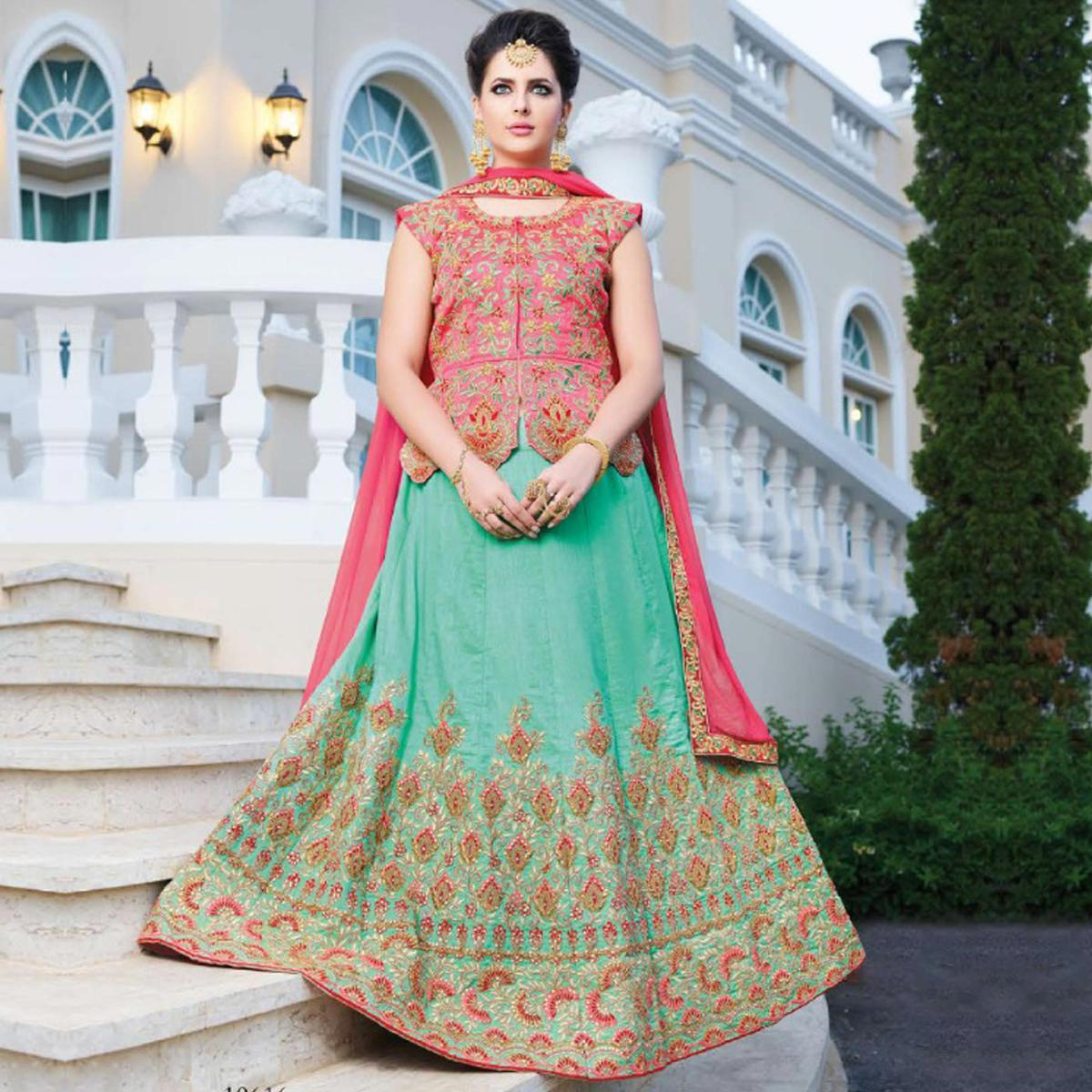 Refreshing Aqua Green Colored Partywear Embroidered Silk Lehenga Choli