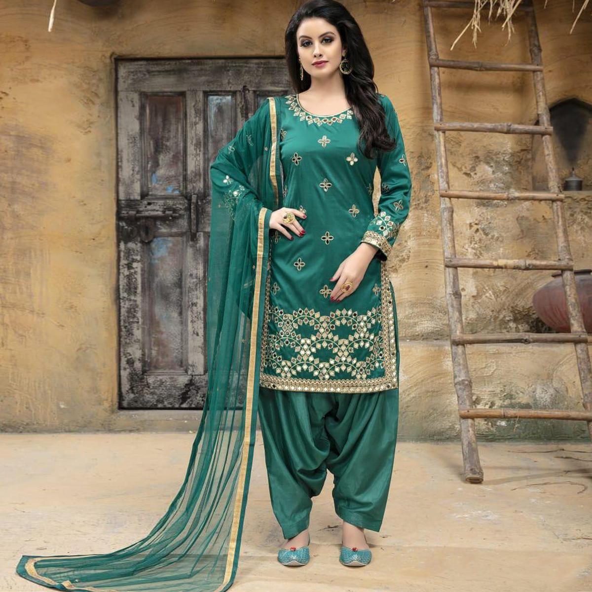 Staring Teal Green Colored Party Wear Embroidered Tapetta Silk Suit