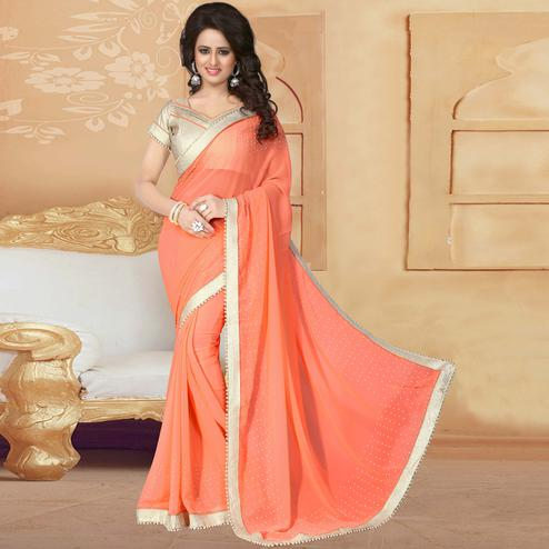 Preferable Peach Colored Party Wear Georgette Saree