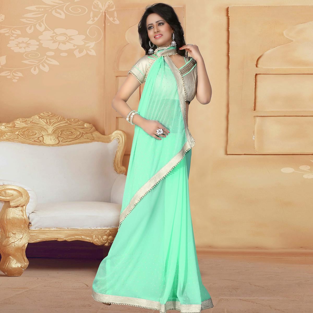 Gorgeous Mint Green Colored Party Wear Georgette Saree