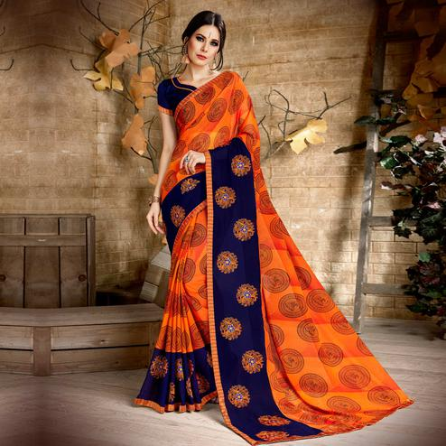 Surpassing Orange Colored Casual Wear Printed Georgette Saree