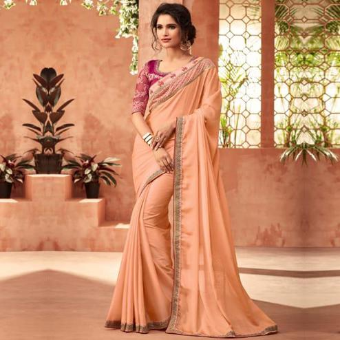 Attractive Peach Colored Partywear Embroidered Silk Saree