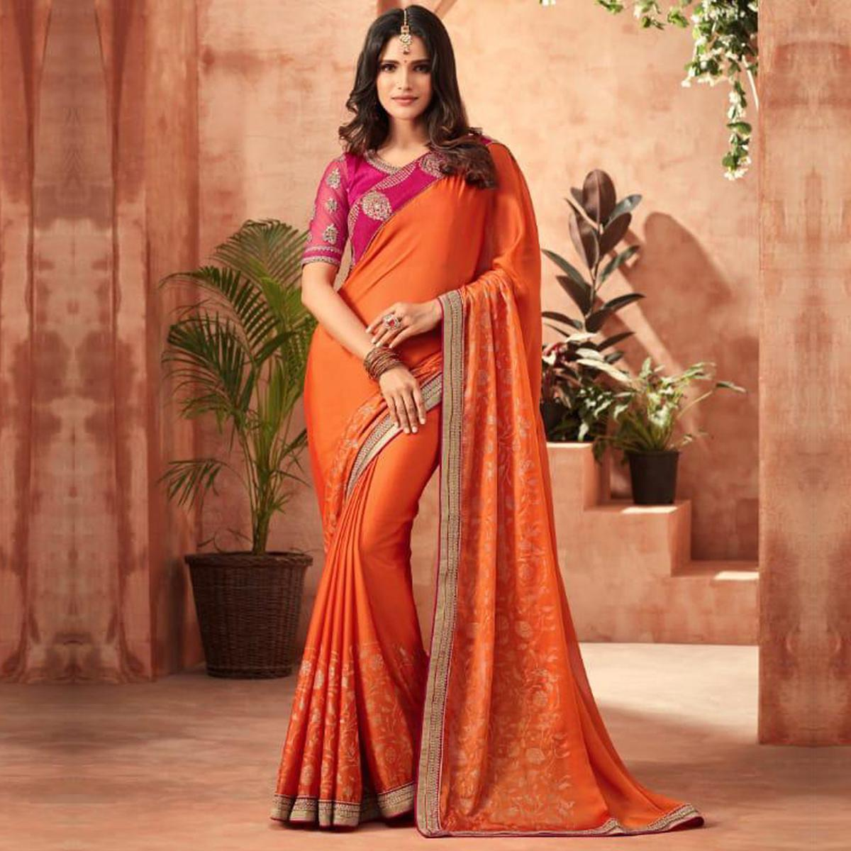 Glowing Orange Colored Partywear Embroidered Chiffon Saree