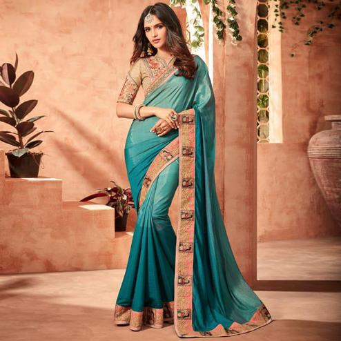Different Turquoise Blue Colored Partywear Embroidered Silk Saree