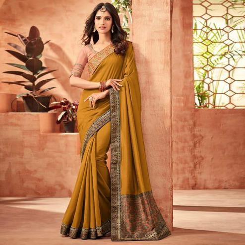 Hypnotic Dark Mustard Yellow Colored Partywear Embroidered Silk Saree