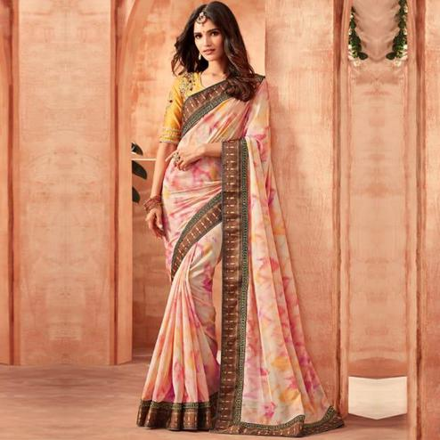 Impressive Light Pink Colored Partywear Embroidered Georgette Saree