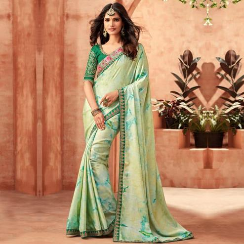 Magnetic Pastel Green Colored Partywear Embroidered Silk Saree