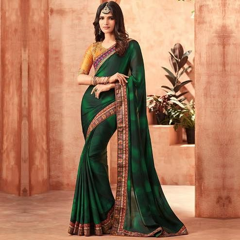 Energetic Dark Green Colored Partywear Embroidered Silk Saree