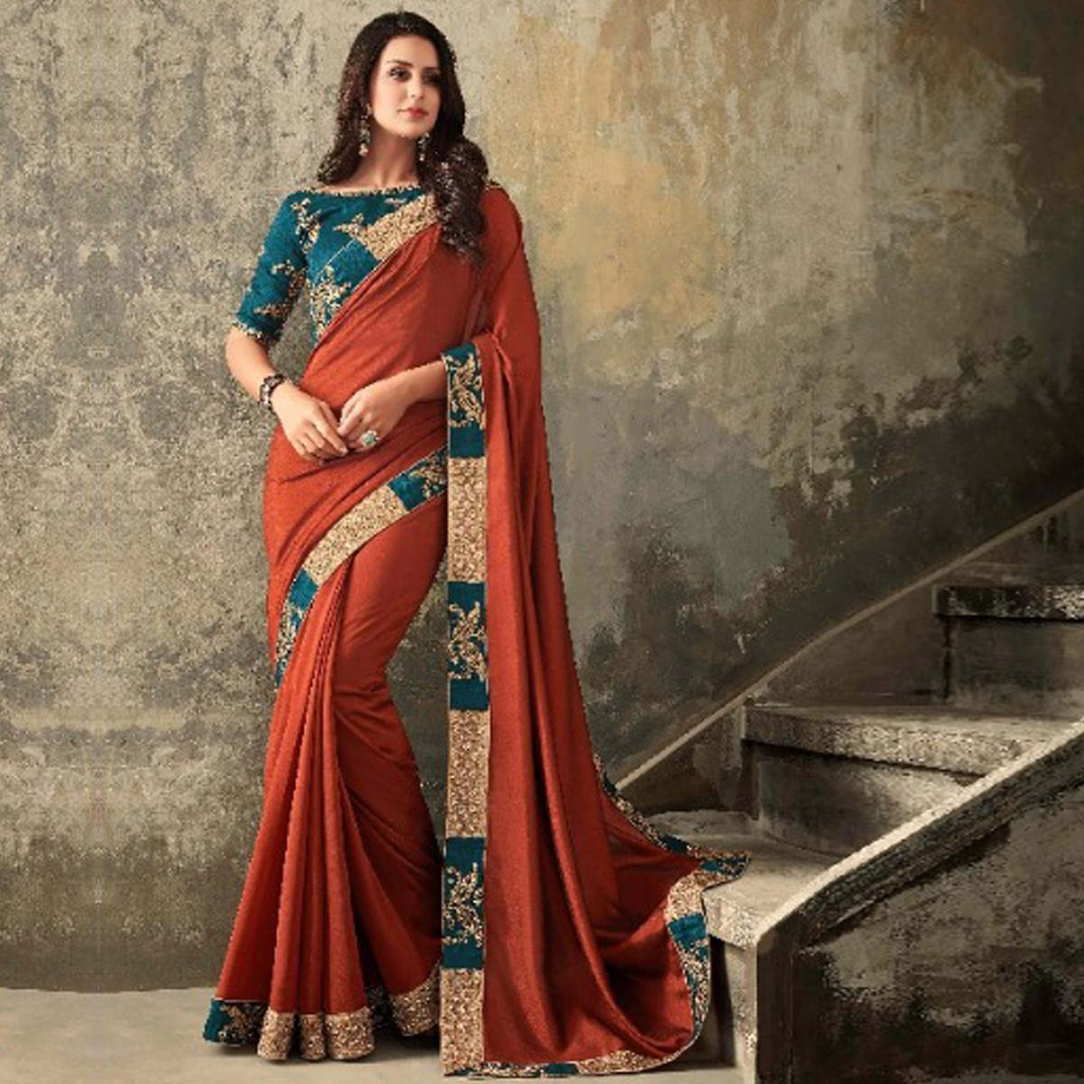 Sensational Rust Orange Colored Party Wear Embroidered Art Silk Saree