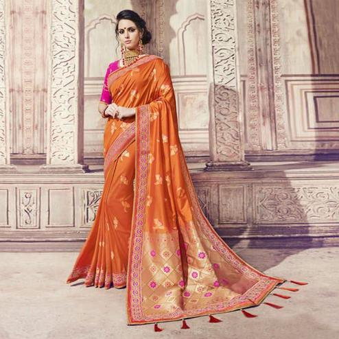 Stunning Orange Colored Partywear Embroidered Banarasi Silk Jacquard Saree