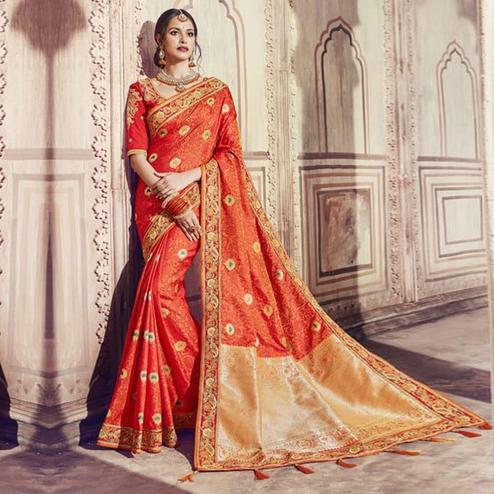 Eye-Catching Orange Colored Partywear Embroidered Banarasi Silk Jacquard Saree