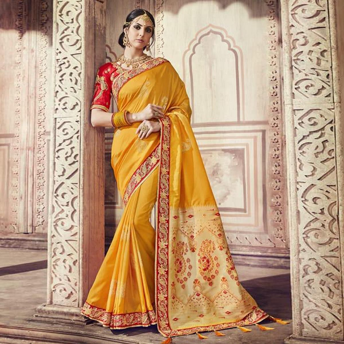 Gleaming Yellow Colored Partywear Embroidered Banarasi Silk Jacquard Saree
