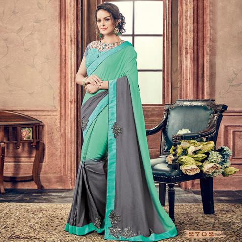 Sophisticated Turquoise & Grey Colored Party Wear Embroidered Rayon Saree