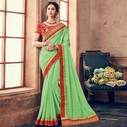 Refreshing Green & Red Colored Party Wear Embroidered Georgette Saree