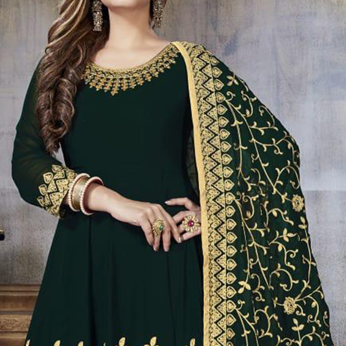Stunning Dark Green Colored Partywear Embroidered Faux Georgette Anarkali Suit