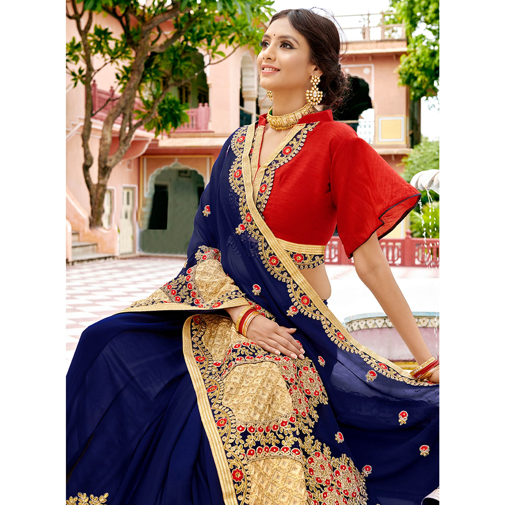 Stunning Dark Blue Colored Partywear Embroidered Georgette Saree
