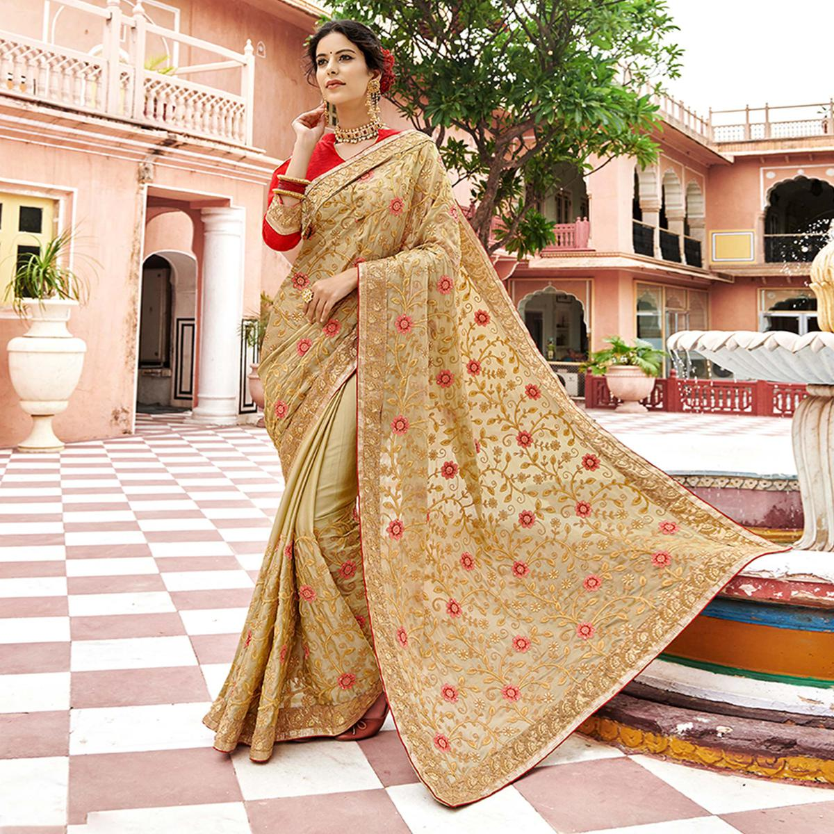 Pleasant Beige Colored Partywear Embroidered Georgette Saree