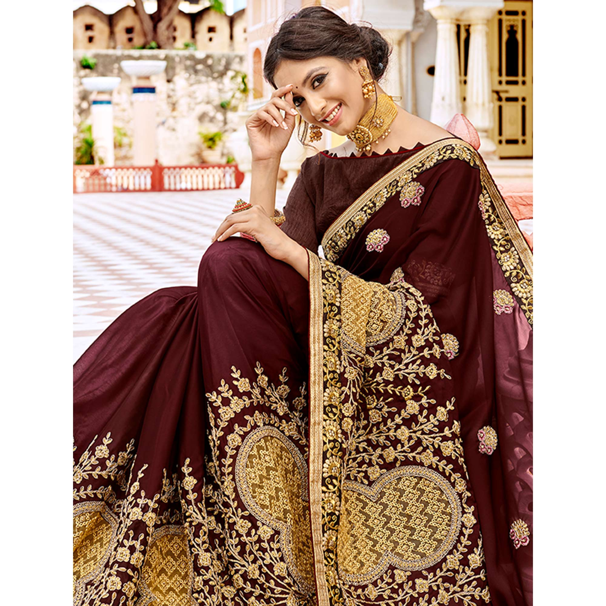 Marvellous Maroon Colored Partywear Embroidered Georgette Saree