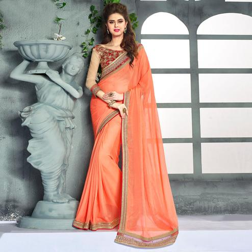 Entrancing Peach Colored Party Wear Embroidered Georgette saree
