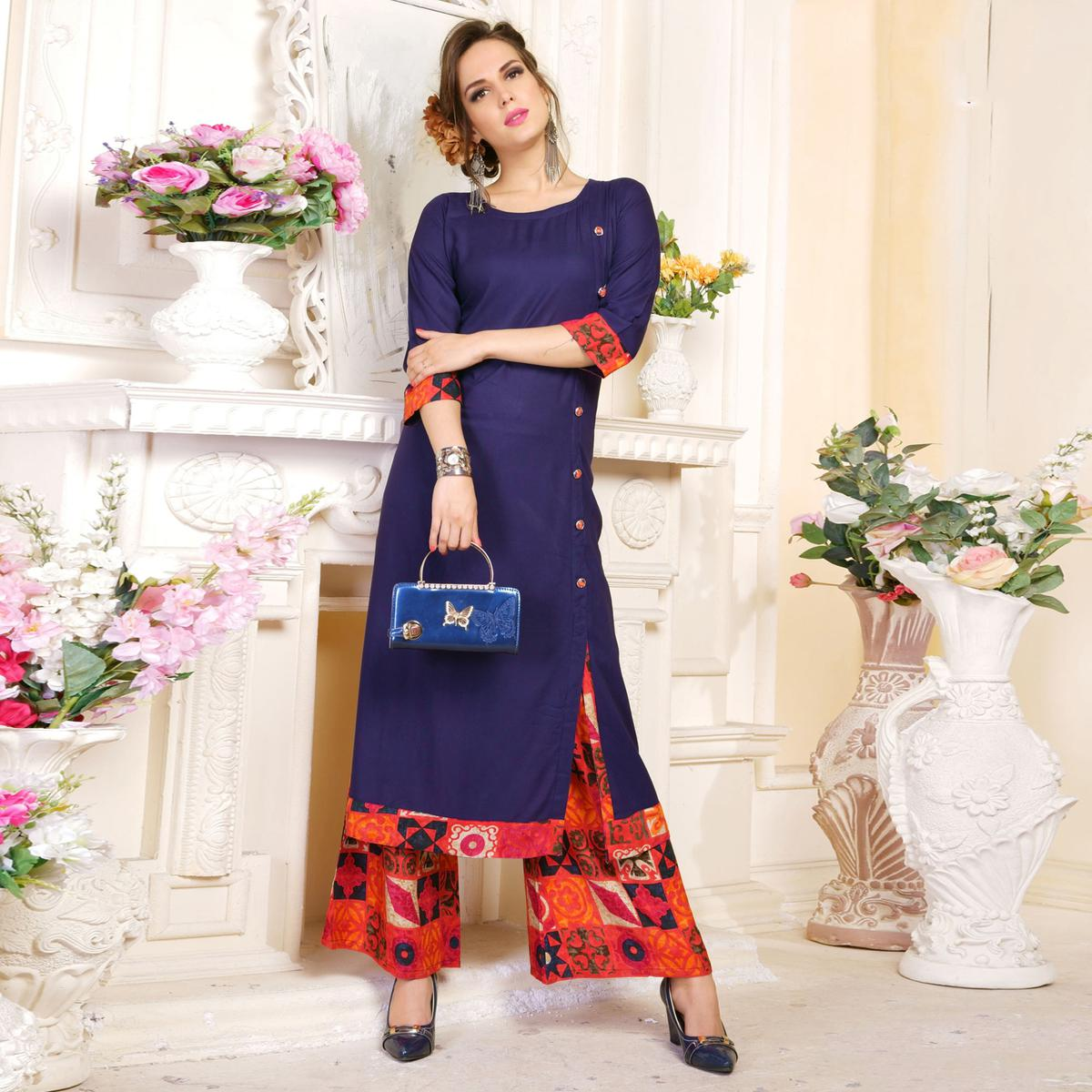 Classy Blue Colored Partywear Printed Rayon Palazzo Suit