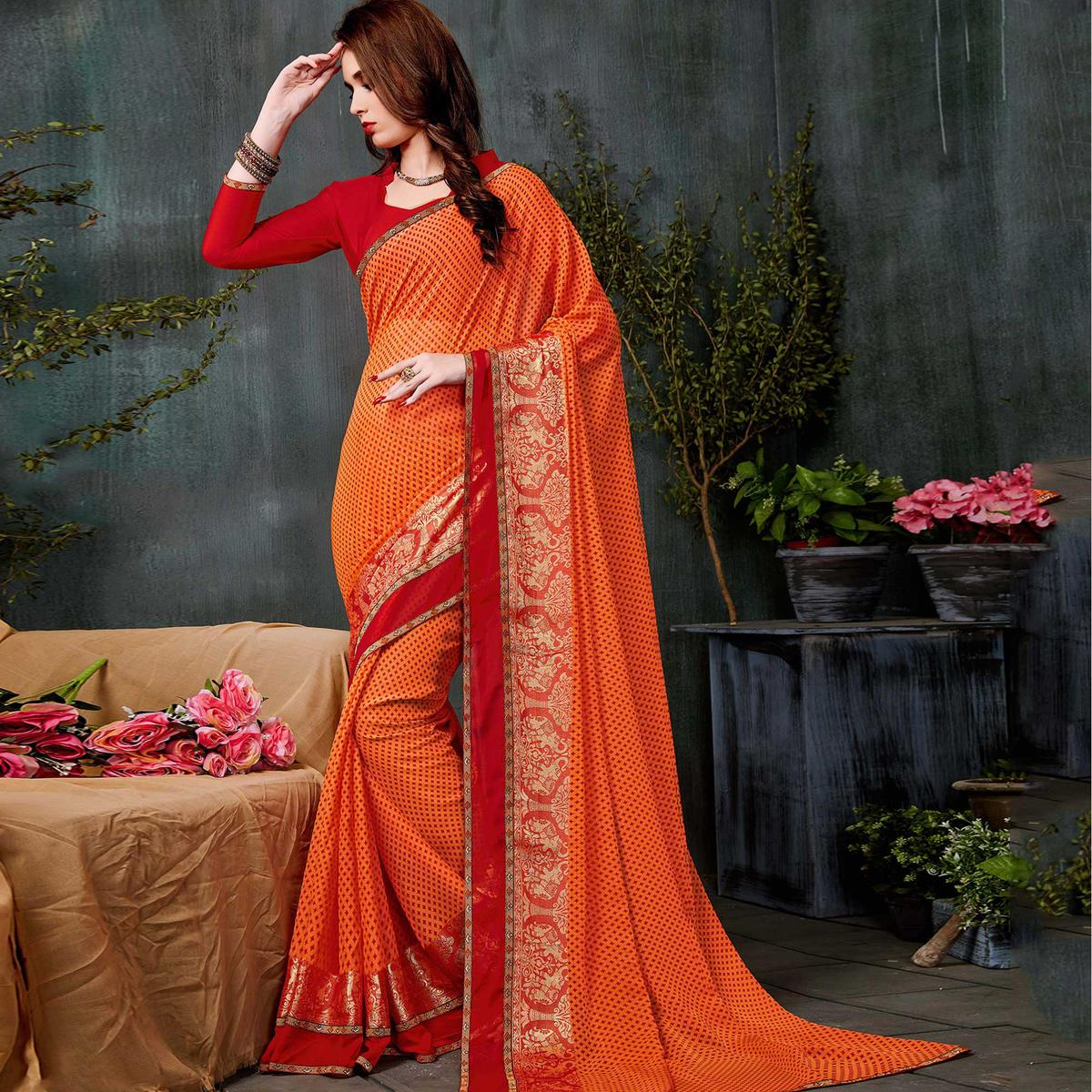 Blooming Orange Colored Casual Printed Georgette Saree