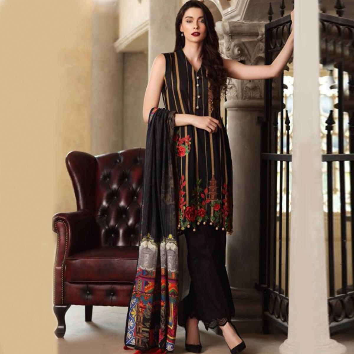 Excellent Black Colored Partywear Printed Pure Cambric Suit
