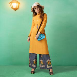 Flattering Yellow Colored Casual Wear cotton Kurti-Palazzo Suit