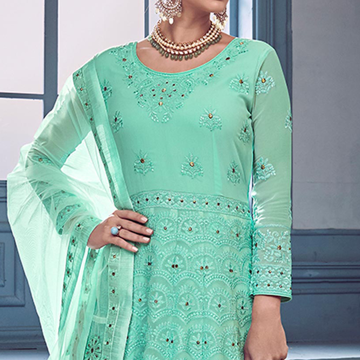 Stunning Aqua Blue Colored Partywear Embroidered Faux Georgette Anarkali Suit