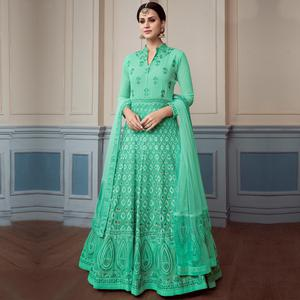 Refreshing Turquoise Green Colored Partywear Embroidered Faux Georgette Anarkali Suit
