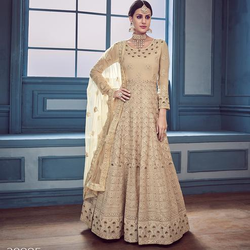 Impressive Beige Colored Partywear Embroidered Faux Georgette Anarkali Suit