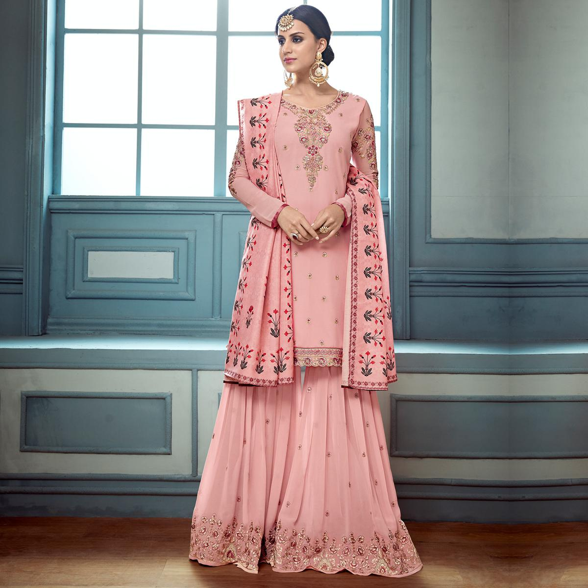 Amazing Pink Colored Partywear Embroidered Faux Georgette Palazzo Suit