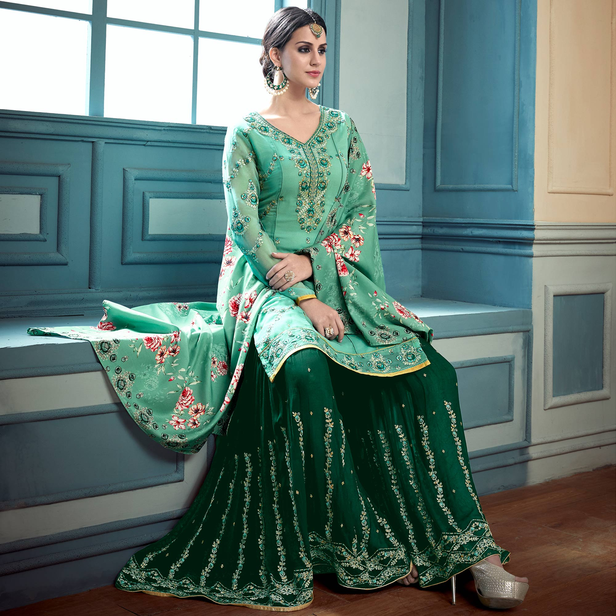 Stunning Turquoise Green Colored Partywear Embroidered Faux Georgette Palazzo Suit