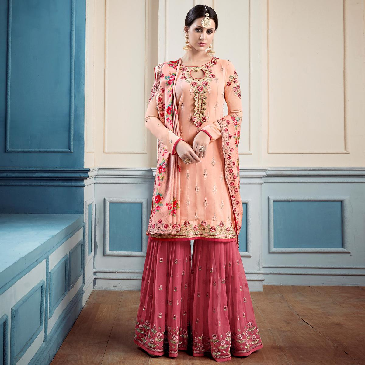 Desiring Peach Colored Partywear Embroidered Faux Georgette Palazzo Suit