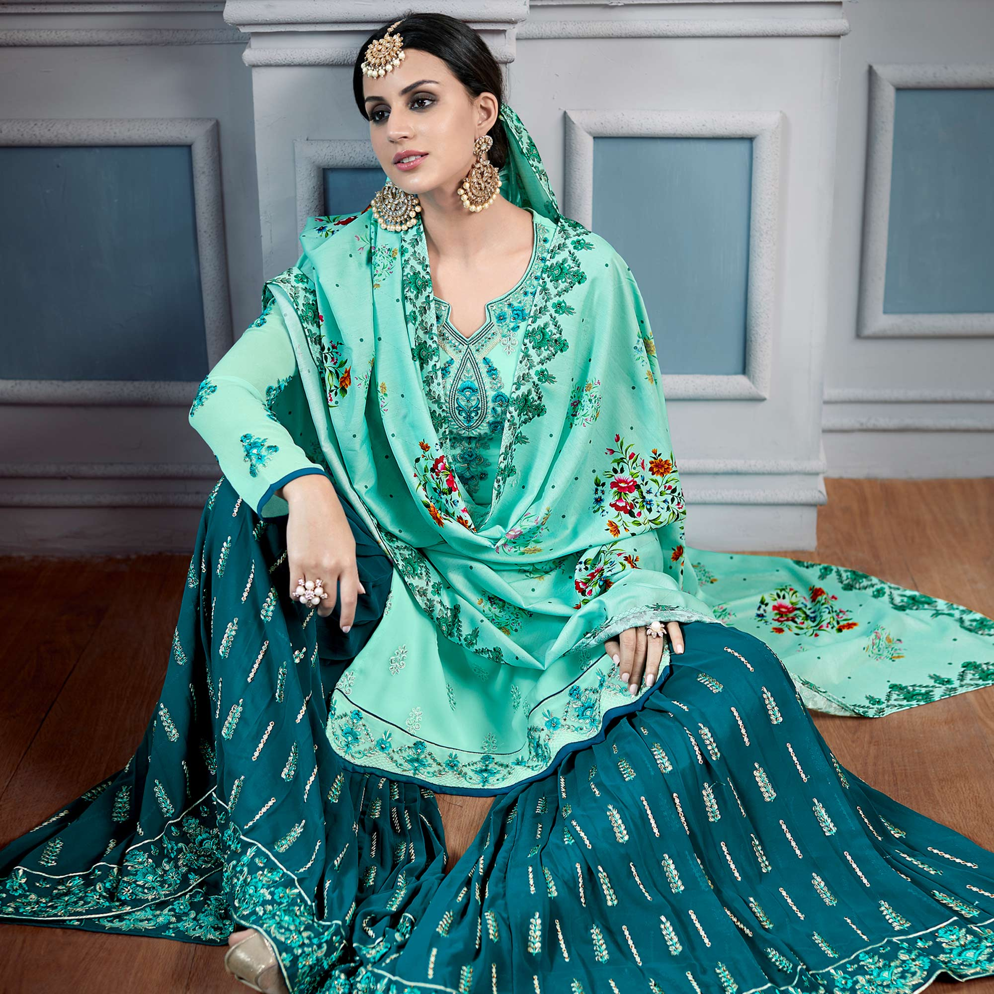 Refreshing Aqua Green Colored Partywear Embroidered Faux Georgette Palazzo Suit