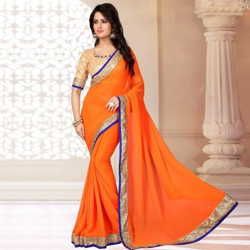 Glowing Orange Colored Partywear Georgette Saree